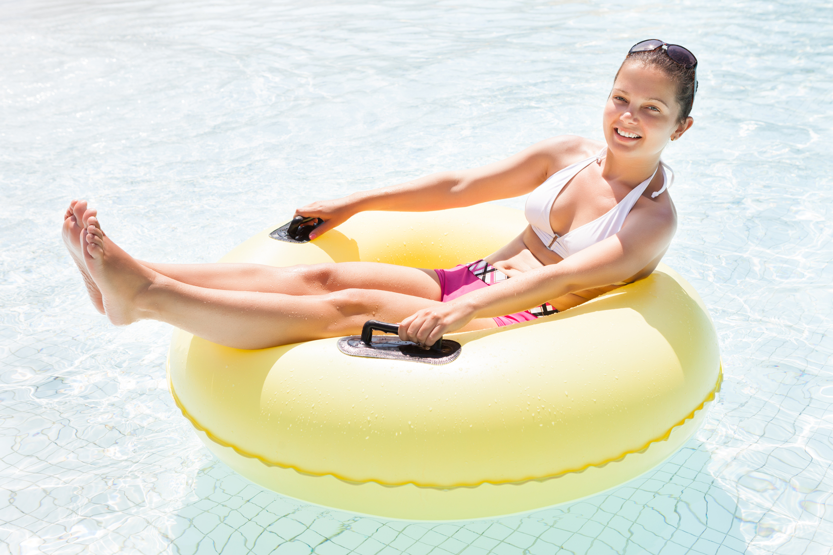 Woman on a floating inner tube