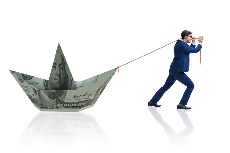 Businessman-pulling-boat-made-from-dollar-banknote