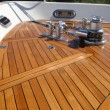 A couple of coats of Amazon teak oil makes this teak deck shine, but without making the surface smooth and slippery like varnish or Cetol would. Photo courtesy of Teak Decking Systems.