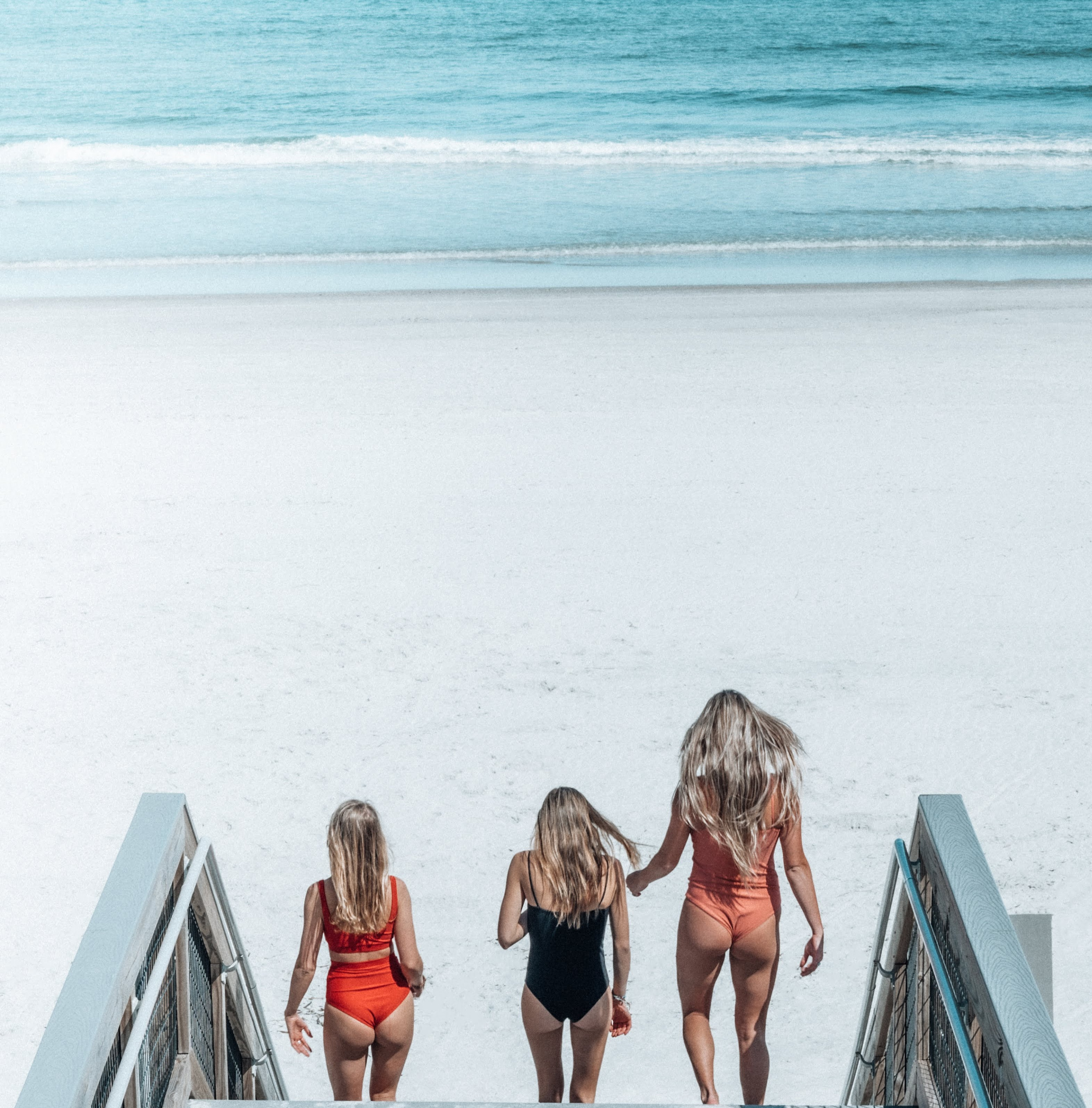Friends heading out for a surf