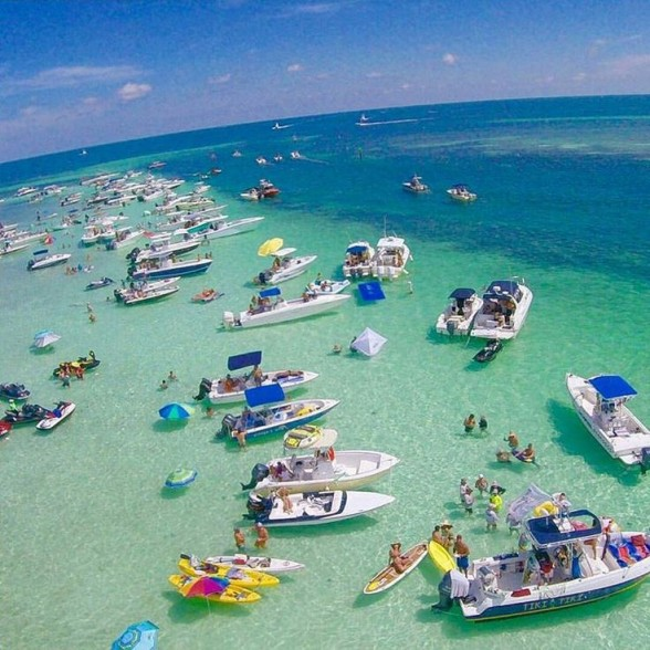 Insert caption. Photo Courtesy: Key Largo Adventures. Crystal clear waters are just one of the many things to enjoy about this party cove at the sandbar in Islamorada, FL. Photo Courtesy: Key Largo Adventures.