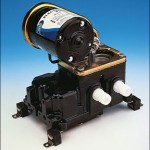 An ITT Jabsco diaphragm bilge pump. These pumps are mounted up and out of the way of nasty bilge conditions, but generally have lower capacities than submersible centrifugal bilge pumps.