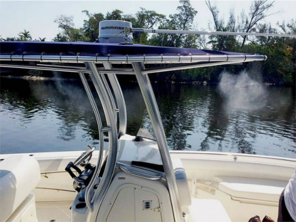 Check out the cool curtain of atomized water coming down from this center-console's soft-top. The mist evaporates quickly, cooling down the air around it. Photo courtesy of Boat Misters.