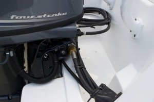 A photo of the fuel supply system on an outboard engine.