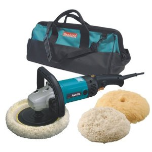 A photo of a Makita angle grinder with buffing accesories.