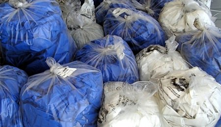 Bags of used shrink wrap await recycling.