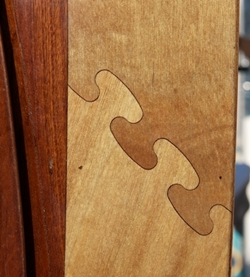 Multiple coats of varnish make this detail on a stitch-and-glue kayak shine. Photo by Gary Reich.