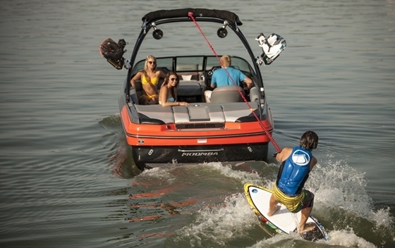 A wakeboard boat runs a V-drive with the engine all the way aft. This makes for a bigger wake and more room for passengers.