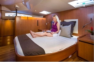 The master stateroom stretches across the full beam of the cat.