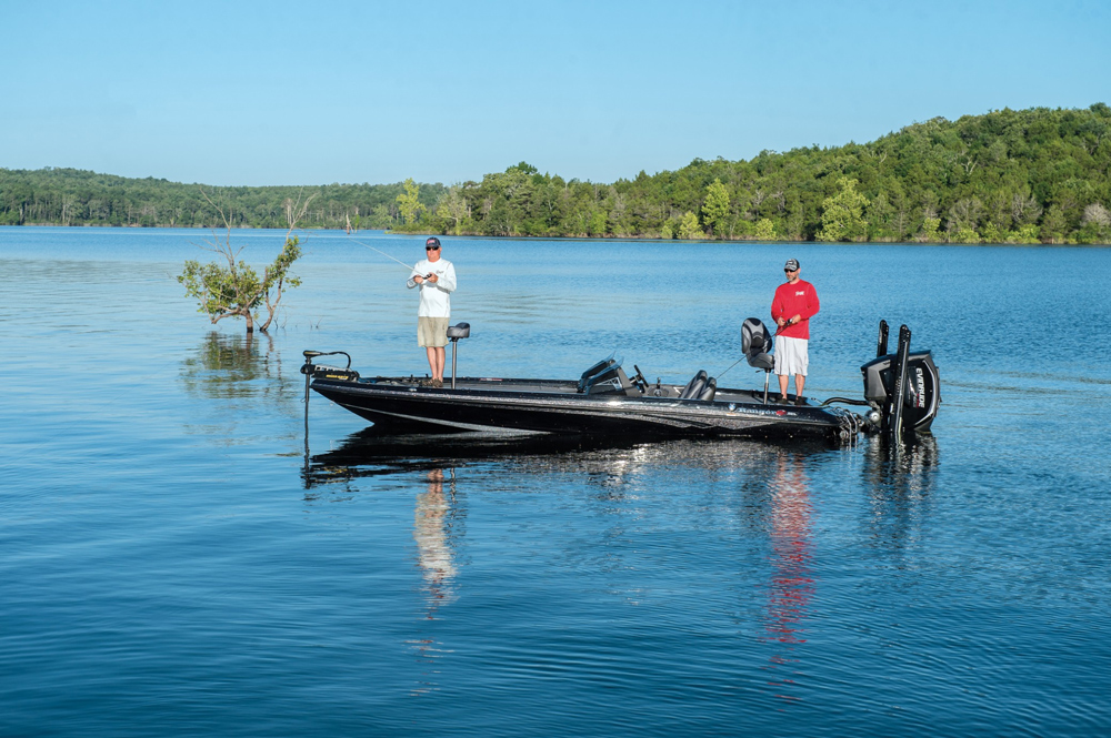 Two anglers fishing onboard a bass boat