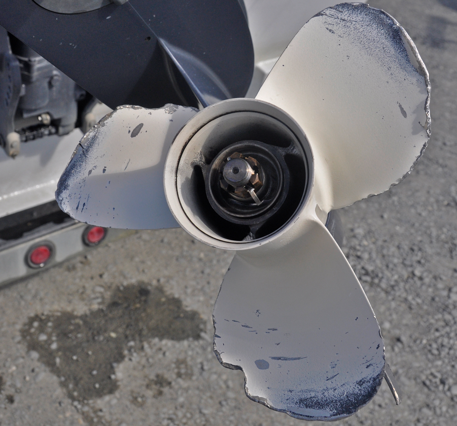 A Damaged Propeller On An Outboard Engine On A Boat