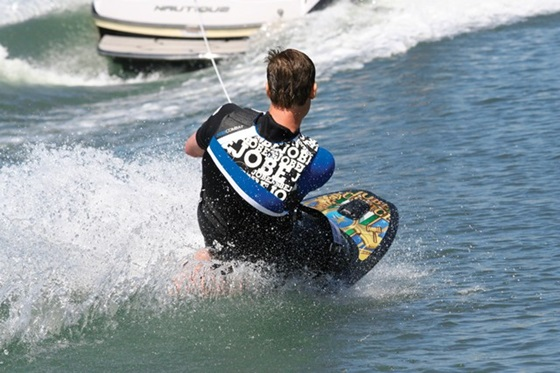 Kneeboarding is a more challenging game than tubing, best tackled by teenagers with supple knees and good back muscles. Photo courtesy of Jobe Sports.