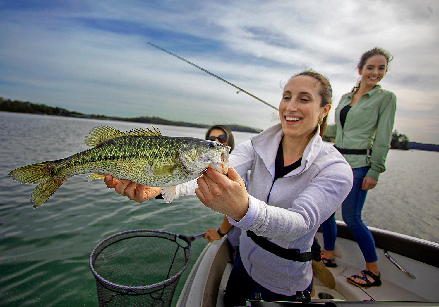 Women Fishing Together On A Boat