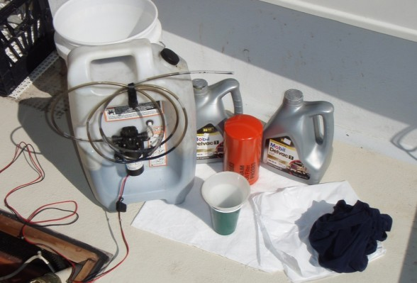 For inboard engines, oil-changing gear includes a pump and reservoir, new filter, and plenty of oil-absorbent pads to prevent messes.