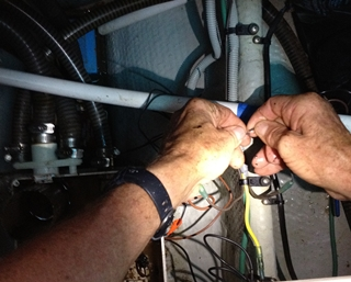 When you get your used boat home, work projects are inevitable -- like rewiring things in the bilge with your headlamp on.