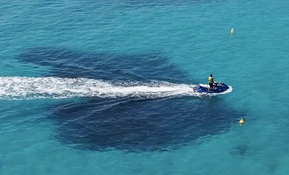 A Rider Navigates Buoys on a PWC in the Bahamas
