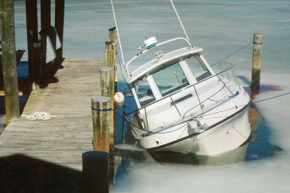 There's nothing wrong with keeping your boat at the dock all winter long, as long as you take the proper precautions. Photo courtesy of BoatUS