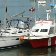 The red tow-boat is postioned on the hip of the disabled sailboat. This helps in maneuvering in close quarters and in calm conditions.