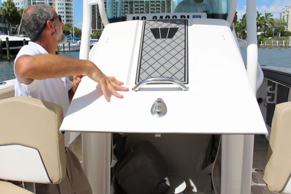 Smart design allows Wellcraft to reap the benefits of a front-entry center console, yet retain the forward cooler seat.