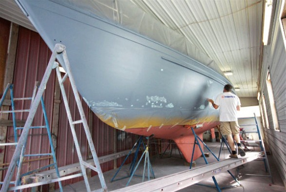 Hull painting and restoration can be an expensive job to hire out, but often gives results that last for decades. Photo by Gary Reich.