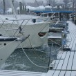 Snow on the dock and anti-ice bubblers at work. In-water storage can work in protected marinas, but engines and all water systems still have to be winterized.