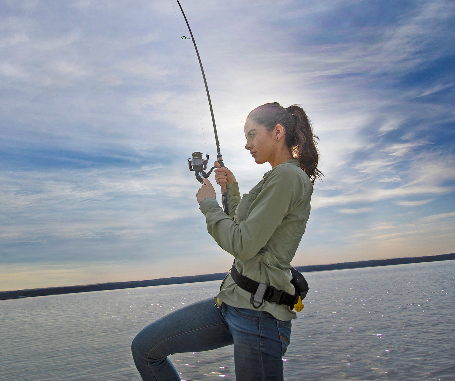 Woman With Fishing Rod On A Boat