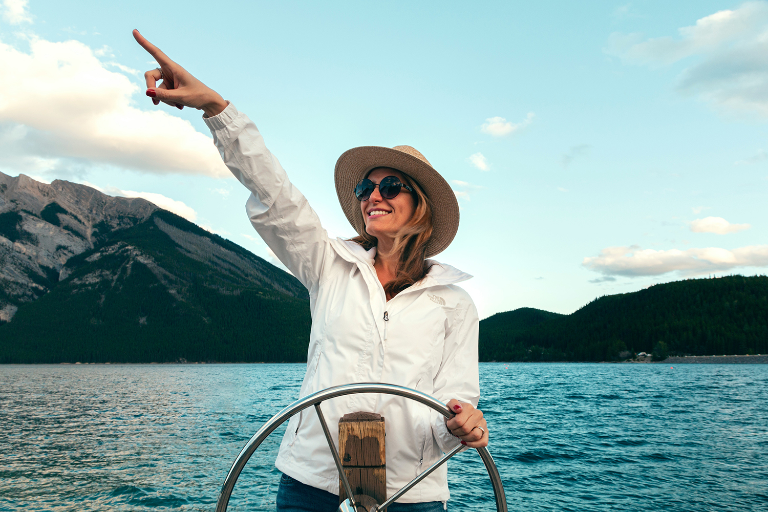 Woman On Boat Pointing Towards Future
